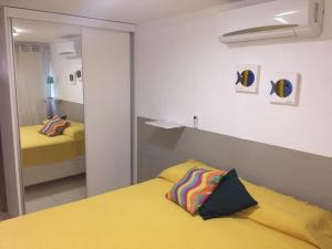 A bed or beds in a room at Porto Plaza Cupe Beach