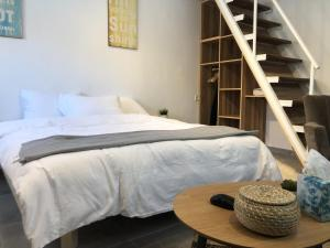 A bed or beds in a room at Locals TLV - Yaffo street