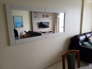 A television and/or entertainment center at Camburiu Apartamento Frente al Mar