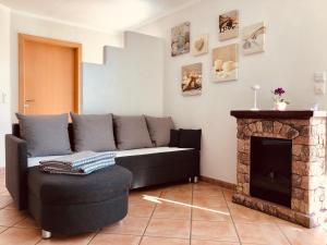 Ein Sitzbereich in der Unterkunft Apartment Casa del Monte