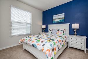 A bed or beds in a room at Windsor at Westside Exec Villas- 2174TC