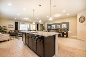 A kitchen or kitchenette at Windsor at Westside Exec Villas- 2174TC