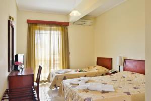 Łóżko lub łóżka w pokoju w obiekcie Evia Studios
