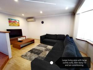 A seating area at Cosy easy access home near Perth CBD and Fremantle