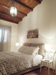 A bed or beds in a room at Baglio San Giovanni