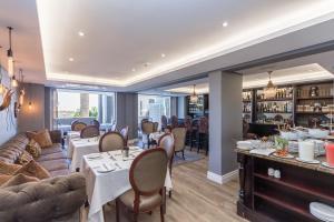 Restoranas ar kita vieta pavalgyti apgyvendinimo įstaigoje Romney Park Luxury Apartments