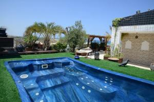 The swimming pool at or near Luxury Beach Suite