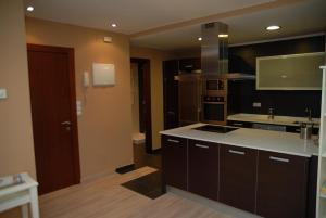 A kitchen or kitchenette at Apartamento Enol