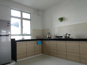 A kitchen or kitchenette at Love&Leisure Homestay 4r3b Opp SPICE Arena Penang