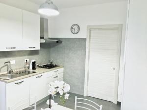 Kuchyň nebo kuchyňský kout v ubytování Casa Vacanze My Roman Dream