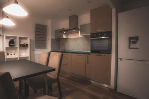 A kitchen or kitchenette at Victoriei Blvd Apartment
