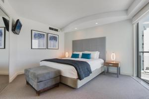 A bed or beds in a room at Mantra Sirocco