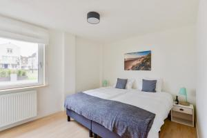 A bed or beds in a room at Spacious Family Holiday Home (7p), Free indoor parking