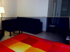 En eller flere senger på et rom på Holiday Flat S.Lorenzo
