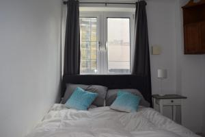 Giường trong phòng chung tại Modern and Homely 2 Bed Flat in Whitechapel
