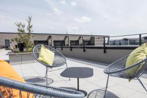 Ein Balkon oder eine Terrasse in der Unterkunft THE FLAG München