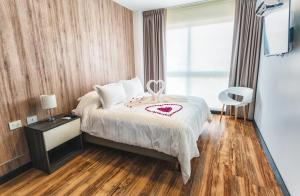 A bed or beds in a room at Urban Suites