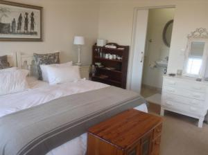 A bed or beds in a room at Driftwood 2