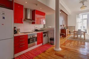 A cozinha ou cozinha compacta de Lisbon Tejo House vista magnífica rio
