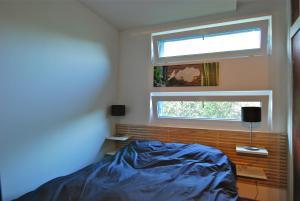 A bed or beds in a room at Gîte Les Deux Hêtres