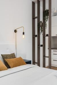A bed or beds in a room at Rajska 3 by Atrium Apartments