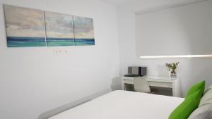 Postel nebo postele na pokoji v ubytování CANARIAS. ISLAS AFORTUNADAS