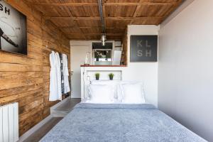 Ein Bett oder Betten in einem Zimmer der Unterkunft Les Cottages d'Annie