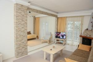A television and/or entertainment center at Panorama View Apartment