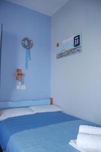 Ένα ή περισσότερα κρεβάτια σε δωμάτιο στο Κάστρα