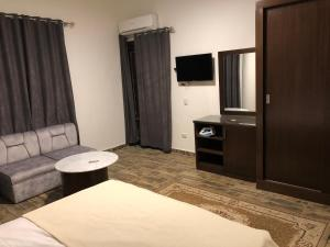 A television and/or entertainment center at Downtown Apartment