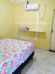 A bed or beds in a room at Casa Peroba Maragogi