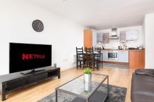 A television and/or entertainment center at Wanderlust Luxury Ensuite Apartments