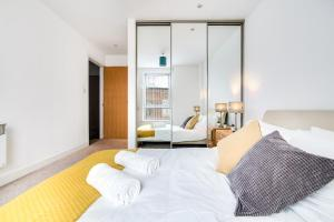 A bed or beds in a room at Wanderlust Luxury Ensuite Apartments