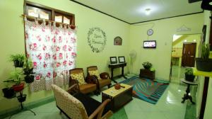 The lobby or reception area at D'Java Homestay Lempuyangan by The Grand Java