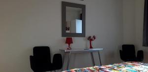 Télévision ou salle de divertissement dans l'établissement Appartement aan Zee Oostende