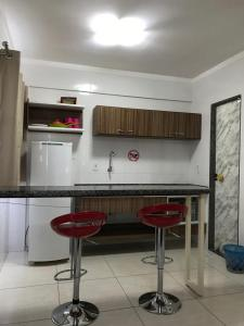 A kitchen or kitchenette at Apartamento Via Caldas L'Acqua II