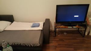 A bed or beds in a room at Blue House Apartment
