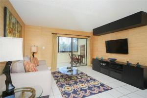 A television and/or entertainment center at Lido Key 07 Home