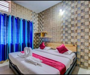 A bed or beds in a room at Sunway Holiday Home