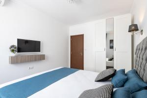 A bed or beds in a room at Apartment Sea Garden