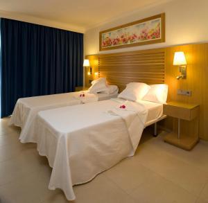 Letto o letti in una camera di Bon Sol Prestige - AB Group