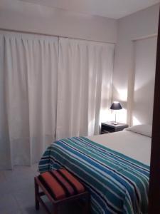 Una cama o camas en una habitación de Tu Lugar en Salta