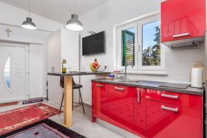 Kuhinja oz. manjša kuhinja v nastanitvi Studio Apartment Madonna