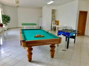 A pool table at TIVOLI APARTMENT by Enjoy Portugal
