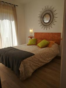 A bed or beds in a room at Apartamento Santa