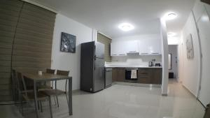 A kitchen or kitchenette at New Fabulous Flat In The Heart Of Kyrenia(Girne)