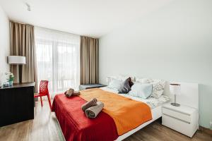 Кровать или кровати в номере Exclusive Apartments in Luka