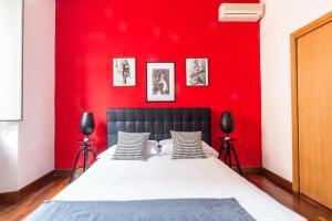 Un ou plusieurs lits dans un hébergement de l'établissement The Italian Suites