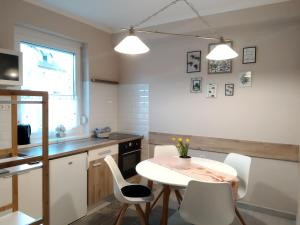 A kitchen or kitchenette at Family Apartman