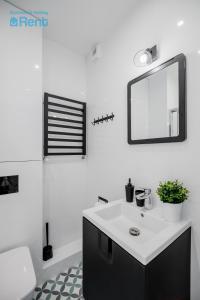 A bathroom at Business&HolidayRent Nowe Apartamenty